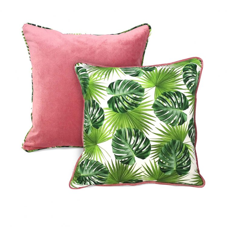 Group shot of blush pink and tropical leaf print cushion covers