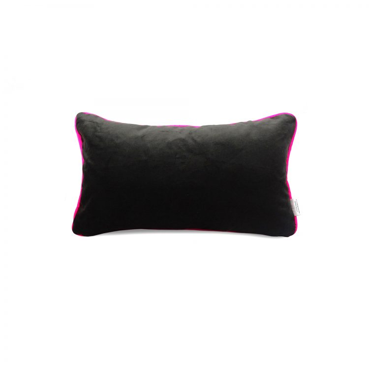 black velvet back of geometric print cushion cover with neon pink piping