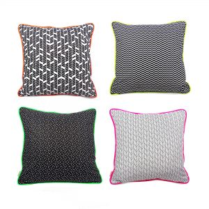 Set of four geometric print cushion covers with neon piping