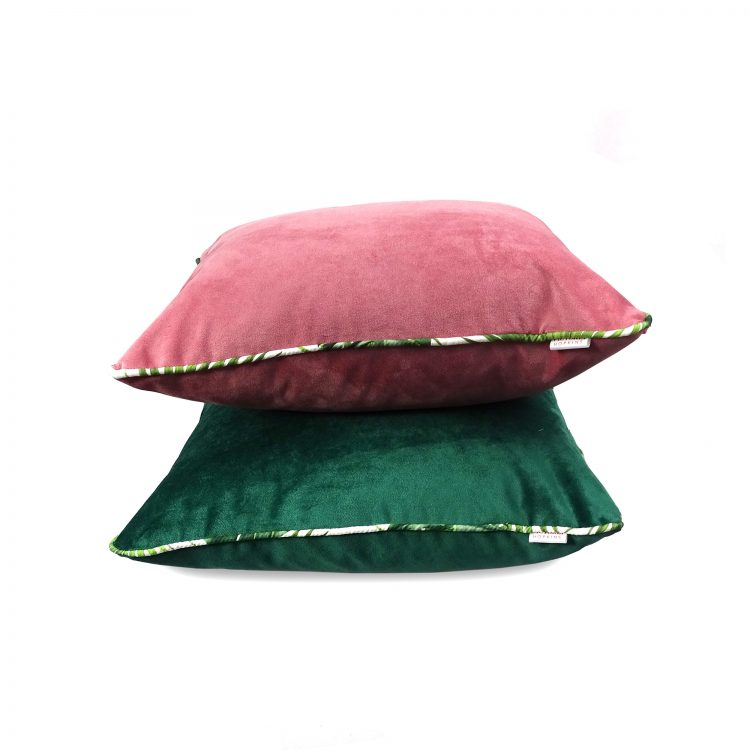 Green velvet and pink velvet cushion covers with tropical leaf piping