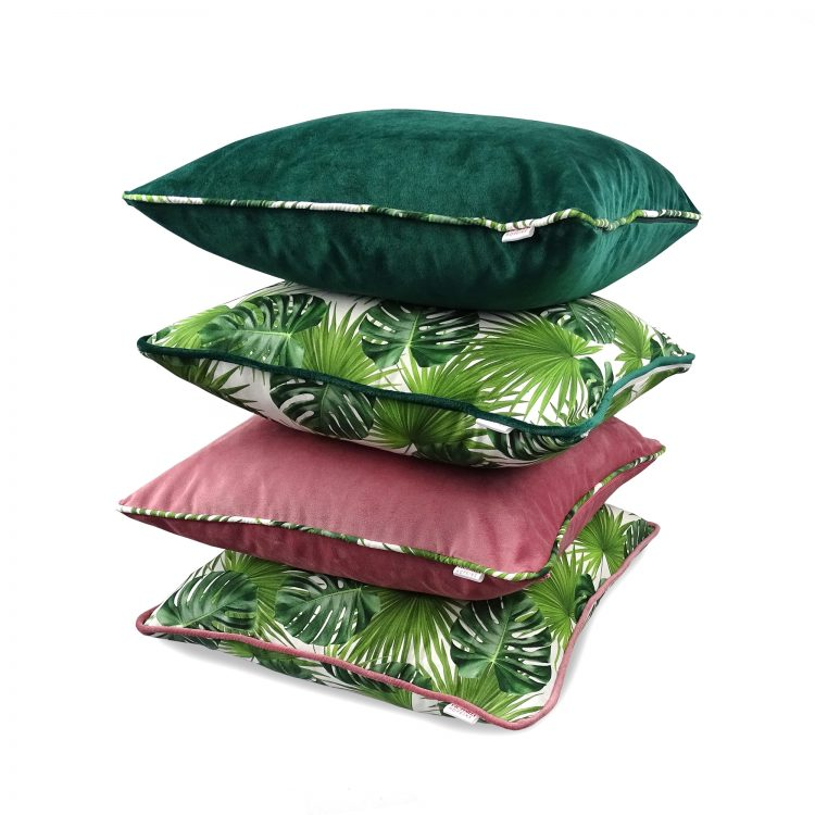 Set of four cushion covers with blush pink and emerald green velvet and tropical leaf print fabric