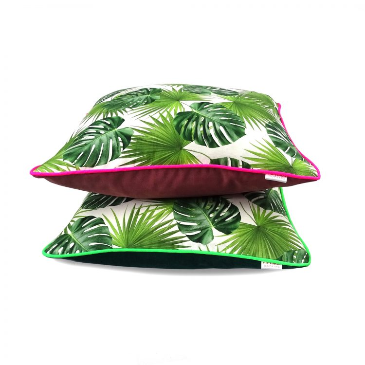 Set of two velvet and tropical leaf print cushion covers with neon piping