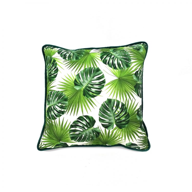 Tropical palm leaf print cushion cover with emerald green velvet piping
