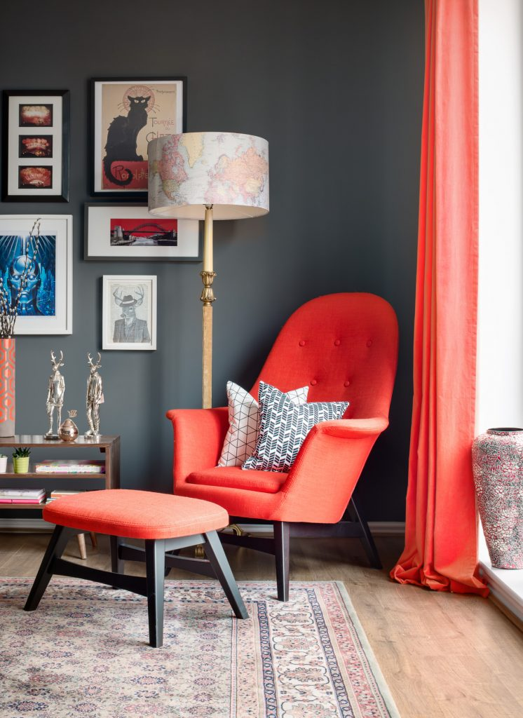 Orange chair with geometric cushions