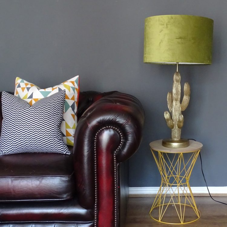 Lime green velvet 40cm drum lampshade next to chair