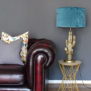 Large teal velvet drum lampshade with sofa