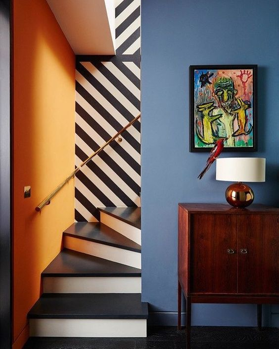 Stairwell with bold colours and black and white stripes